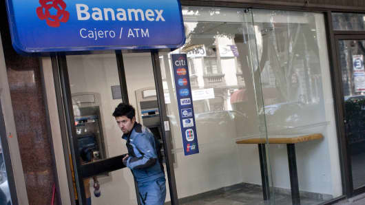 A customer exits a Citigroup Inc. Banamex bank branch in Mexico City, Mexico.