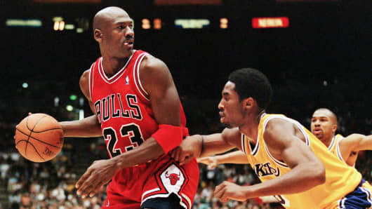 8d076ef53ba Michael Jordan of the Chicago Bulls (L) eyes the basket as he is guarded