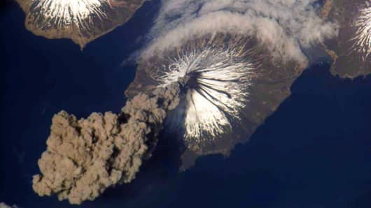 In this photo provided by NASA, The eruption of the Cleveland Volcano is seen as photographed by an Expedition 13 crewmember on the International Space Station May 23, 2009 in the Aleutian Islands, Alaska. The Cleveland Volcano has erupted again yesterday sending a cloud of ash 15,000 feet into the sky according to reports on December 30, 2011.