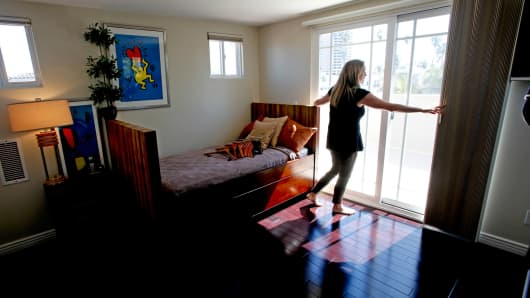 A real estate agent readies a house for viewing in Venice, Calif.