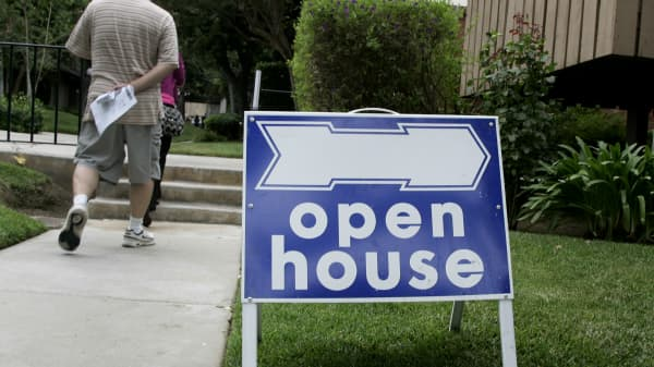 Potential homebuyers arrive for an open house in Arcadia, Calif.