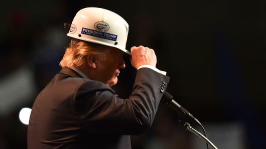 Republican presidential candidate Donald Trump wears a coal miner's protective hat while addressing his supporters during a rally at the Charleston Civic Center on May 5, 2016 in Charleston, WV.