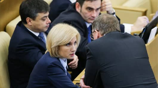 State Duma member Olga Batalina (C) at a Russian State Duma plenary meeting discussing a draft law decriminalizing some forms of domestic violence.