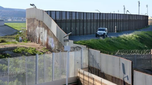 A Border Patrol vehicle sits along the U.S.-Mexico border wall on January 25, 2017 in San Ysidro, California.