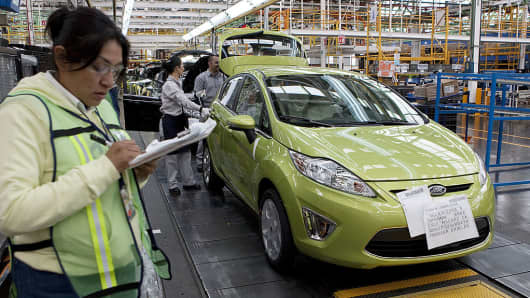 Employees work on the assembly line producing the new Ford Fiesta car, at the Ford Motor Co. plant in Cuautitlan Izcalli, Mexico