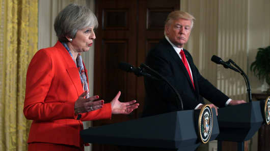 British Prime Minister Theresa May speaks as President Donald Trump looks on in a joint press conference at the East Room of the White House January 27, 2017 in Washington, DC.