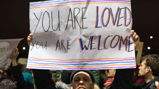 Protesters outside Terminal 5 of O'Hare International Airport demand that travelers detained inside due to President Trump's order to ban people from seven predominantly Muslim countries are released on January 28, 2017.