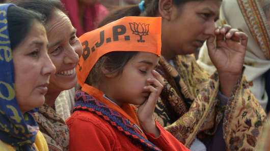 Villagers listen to Finance Minister Arun Jaitley during a BJP-SAD alliance election campaign rally at a village called Rajasansi, located about 12 kms from Amritsar on January 29, 2017.