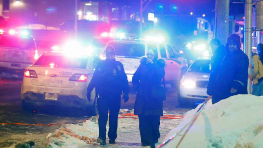 Police officers are seen near a mosque after a shooting in Quebec City, January 29, 2017.