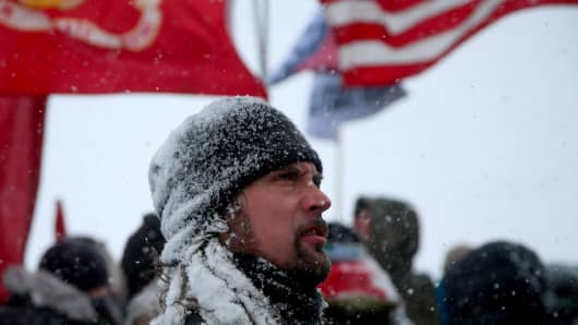 "Marine veteran Troy Therrien, 46, from Sturgeon Bay, Mich., takes part in a march with other veterans and activists outside the Oceti Sakowin camp where ""water protectors"" continue to demonstrate against plans to pass the Dakota Access pipeline adjacent to the Standing Rock Indian Reservation, near Cannon Ball, N.D."