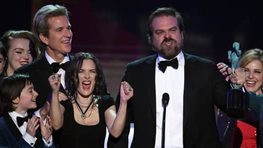 Winona Ryder and David Harbour of 'Stranger Things' accept the Outstanding Performance by an Ensemble in a Drama Series onstage during The 23rd Annual Screen Actors Guild Awards