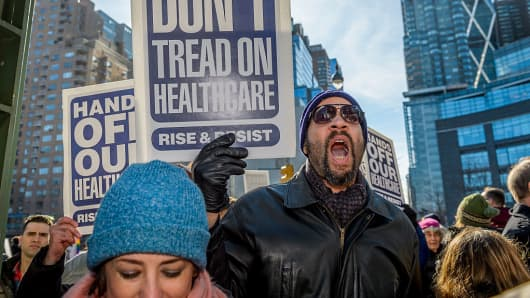 People demonstrate at Trump International Hotel and Tower in New York City, to fight against the proposed changes to the American healthcare system proposed by the Trump Administration and Republicans.