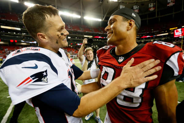 Tom Brady #12 of the New England Patriots and Tony Gonzalez #88 formerly of the Atlanta Falcons.