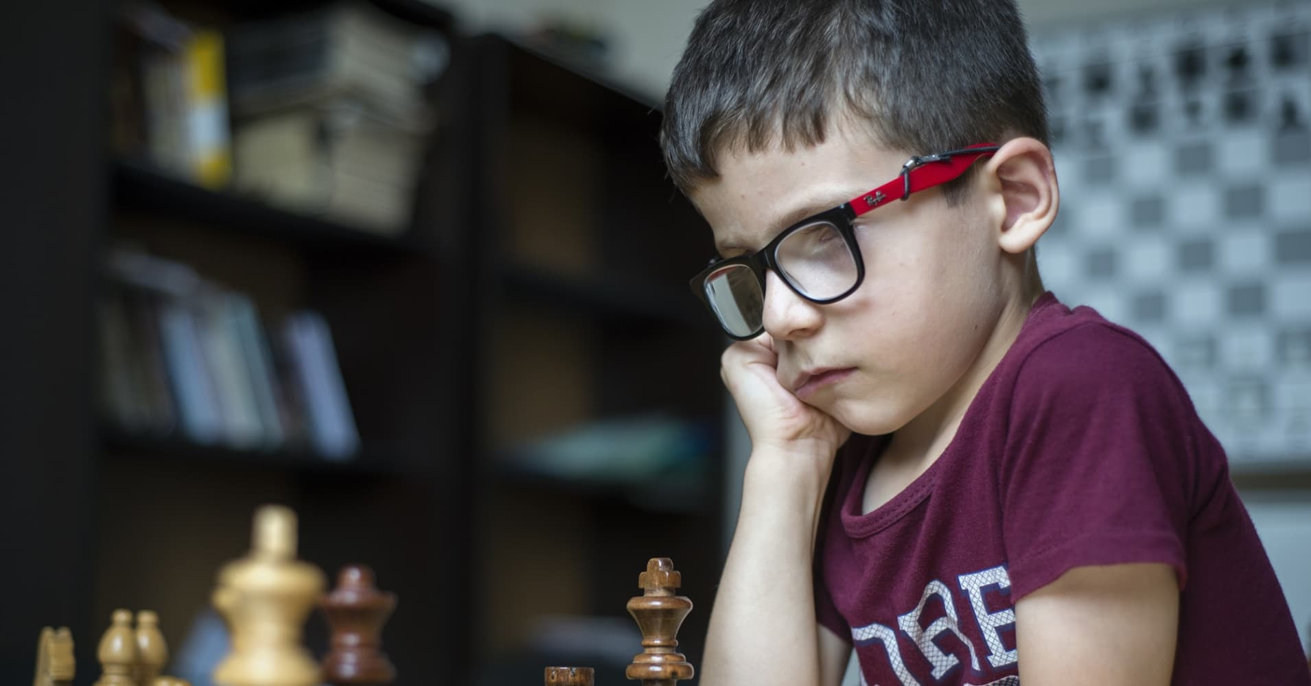 A learner of the Quba Chess School plays chess during a training lesson, Azerbaijan.