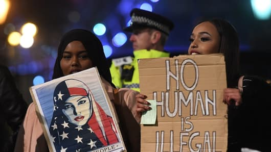 People demonstrate during a protest at Downing Street in central London against US President Donald Trump's controversial travel ban on refugees and people from seven mainly-Muslim countries.