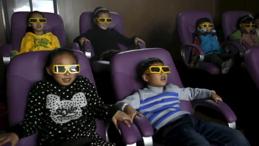 Children watch a 3D movie at a theater in Hefei, Anhui province.