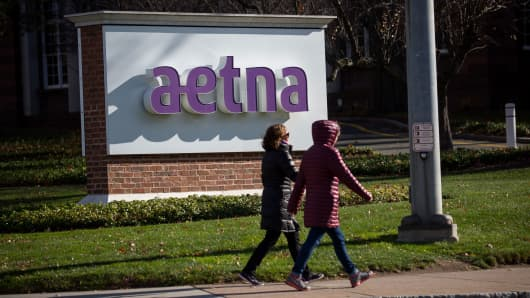 Pedestrians walk past Aetna headquarters in Hartford, Connecticut.