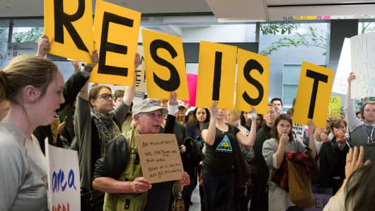 Protesters gather at the International Terminal Arrival Hall of San Francisco International Airport on January 29, 2017 to demonstrate against President Donald Trump's Muslim ban.