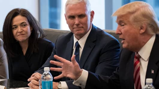 Sheryl Sandberg, chief operating officer of Facebook, Vice President-elect Mike Pence listen as President-elect Donald Trump speaks during a meeting of technology executives at Trump Tower, December 14, 2016 in New York City.