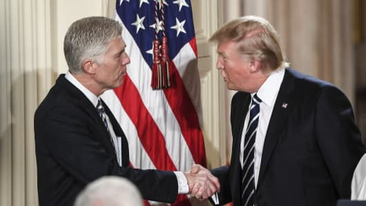 President Trump shakes the hand of Judge Neil Gorsuch during a Supreme Court of the United States nominee announcement in the East Room at the White House in Washington, DC on Tuesday, Jan. 31, 2017.