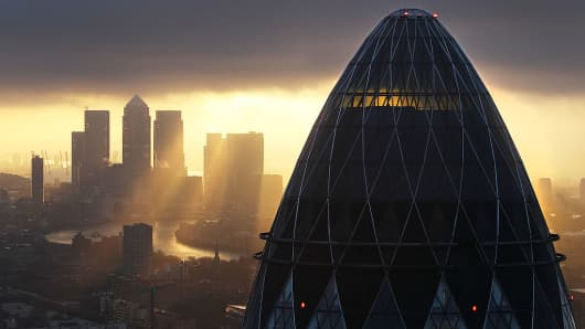 The sun rises over the City of London on February 25, 2010