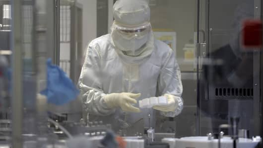 An employee works in an unit dedicated to the production of insulin pens at the factory of the US pharmaceutical company Eli Lilly in Fegersheim, eastern France.