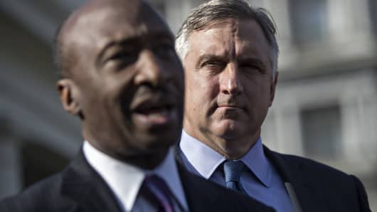 Robert Bradway, president and chief executive officer of Amgen Inc., listens as Ken Frazier, chairman and chief executive officer of Merck & Co., left, speaks during a news conference outside the White House following a meeting with U.S. President Donald Trump, not pictured, in Washington, D.C.
