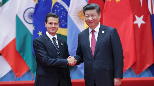 Chinese President Xi Jinping (right) shakes hands with Mexican President Enrique Pena Nieto at the 11th G20 Leaders Summit on September 4, 2016 in Hangzhou, China.