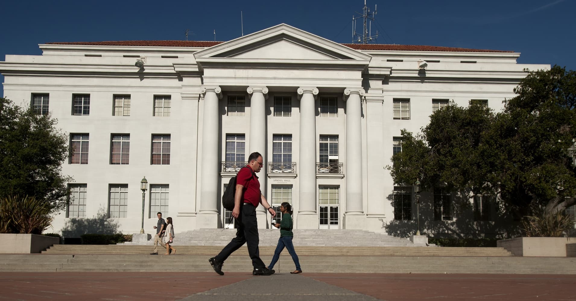 Pedestrians pass Sproul Hall, the University of California at Berkeley's administration building.