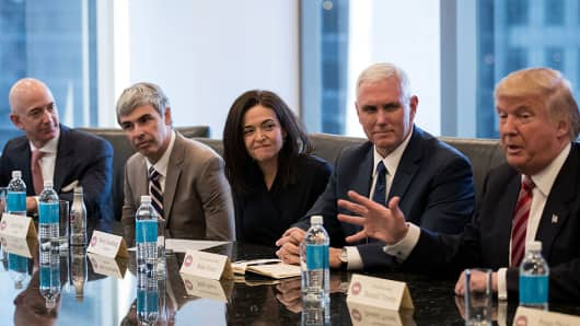(L to R) Jeff Bezos, chief executive officer of Amazon, Larry Page, chief executive officer of Alphabet Inc. (parent company of Google), Sheryl Sandberg, chief operating officer of Facebook, Vice President-elect Mike Pence listen as President-elect Donald Trump speaks during a meeting at Trump Tower, December 14, 2016 in New York City.
