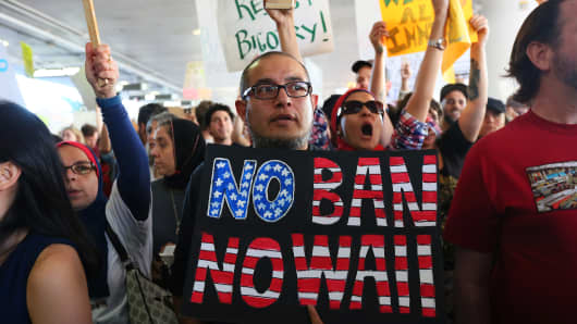 Demonstrators yell slogans during protest against the travel ban imposed by U.S. President Donald Trump's executive order, at Los Angeles International Airport in Los Angeles, California, U.S., January 29, 2017.
