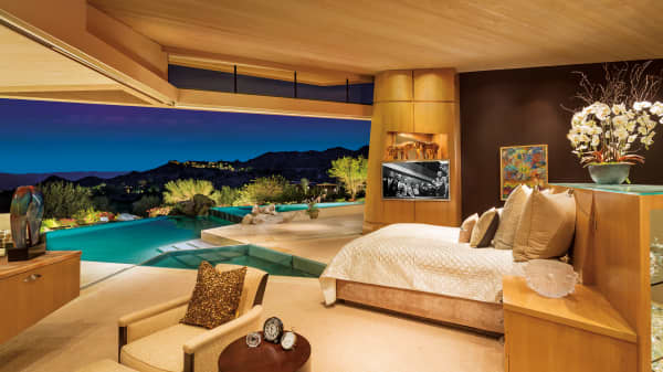 The late Jerry Weintraub's desert mansion's master bedroom has a pool that begins at the foot of the bed.