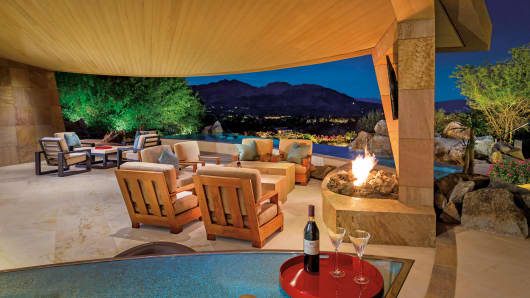 The 9,152-square-foot Palm Desert home overlooks the Bighorn Golf Club.