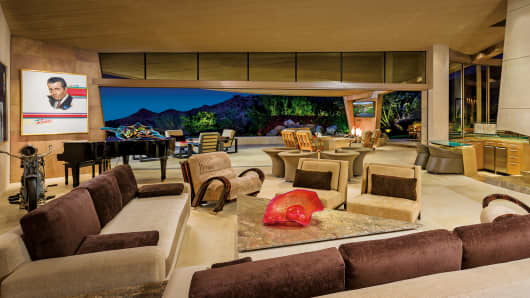 The living room has a great view of the rugged mountains surrounding it.