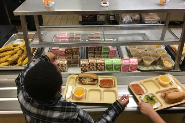 File photo, students fill their lunch trays at J.F.K Elementary School in Kingston, N.Y., where all meals are now free under the federal Community Eligibility Provision.