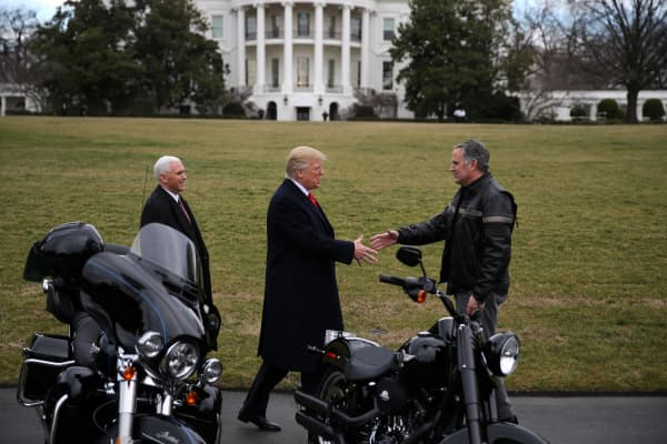 President Donald Trump shakes hands with Matthew S Levatich, CEO of Harley Davidson during a visit of the company's executives at the White House in Washington U.S., February 2, 2017.