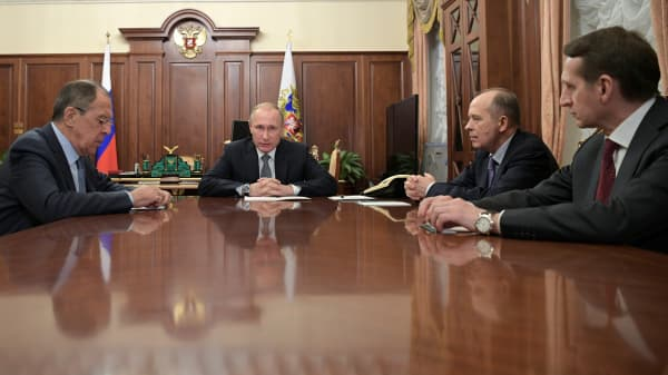 Russia's President Vladimir Putin (2nd L), Foreign Minister Sergei Lavrov (L), Director of Russian Federal Security Service (FSB) Alexander Bortnikov (2nd R), and Director of Foreign Intelligence Service (SVR) Sergei Naryshkin at the Kremlin in Moscow on Dec. 19, 2016.