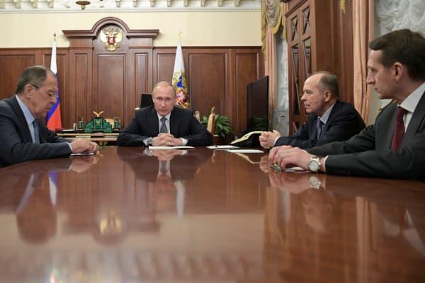 Russia's President Vladimir Putin (2nd L), Foreign Minister Sergei Lavrov (L), Director of Russian Federal Security Service (FSB) Alexander Bortnikov (2nd R), and Director of Foreign Intelligence Service (SVR) Sergei Naryshkin at the Kremlin in Moscow on Dec. 19, 2016.