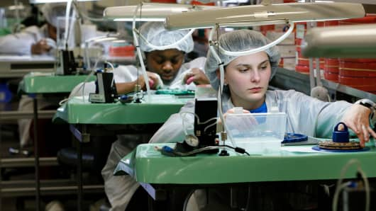 Khokeyma Reed assembles a watch at the Shinola Watch factory on January 4, 2017 in Detroit, Michigan.