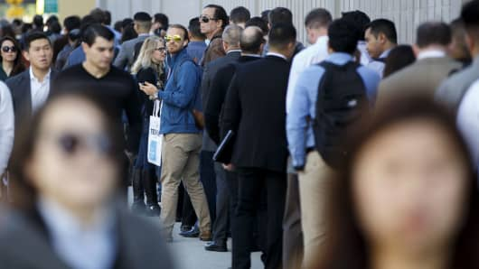 Job seekers wait in line during the TechFair LA job fair in Los Angeles, California.