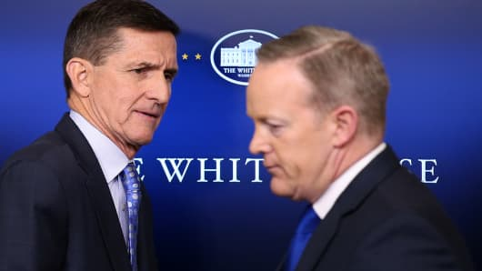 National security adviser General Michael Flynn (L) arrives to deliver a statement next to Press Secretary Sean Spicer during the daily briefing at the White House in Washington U.S., February 1, 2017.