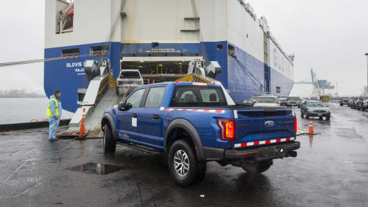 Ford F-Series trucks loaded onto a transport chip destined for the China market.