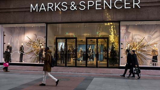 Pedestrians walk past the Marks & Spencer flagship store on December 21, 2015 in Beijing, China. The retailer has since exited the Chinese market.