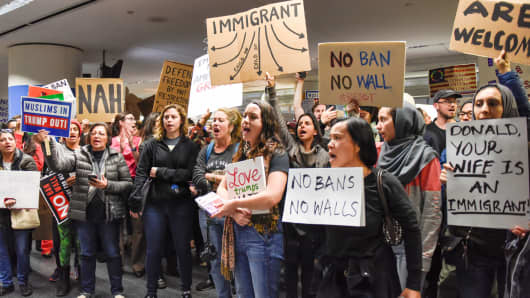 Demonstrators yell slogans during an anti-Donald Trump immigration ban protests inside the San Francisco International Airport, January 29, 2017.