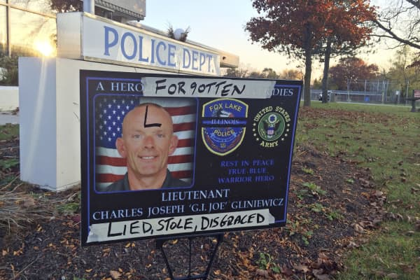 In this photo Nov. 4, 2015 file photo, a sign honoring Fox Lake Police Lt. Charles Joseph Gliniewicz is defaced outside Fox Lake Police Department in Fox Lake, Ill. Lake County officials confirmed that Gliniewicz, 52, died Sept. 1 of a self-inflicted gunshot wound.