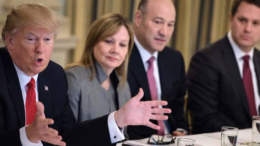 Mary Barra (2ndL), CEO of General Motors, Gary Cohn (2ndR), President of President of Goldman Sachs, and Doug McMillon (R), CEO of Walmart, listen while US President Donald Trump speaks before a policy and strategy forum with executives in the State Dining Room of the White House February 3, 2017 in Washington, DC.