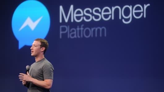 Mark Zuckerberg introduces a messenger platform at the F8 summit.