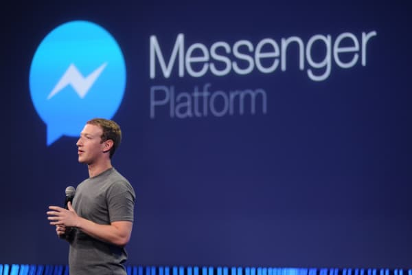 Mark Zuckerberg introduces a messenger platform at the F8 summit.