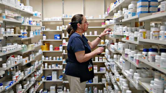 A pharmacy technician fills a prescription inside a Walmart store in Trevose, Pa.