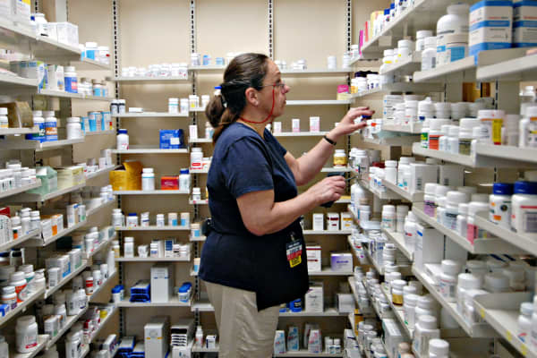 A pharmacy technician fills a prescription inside a Wal-Mart store in Trevose, Pa.